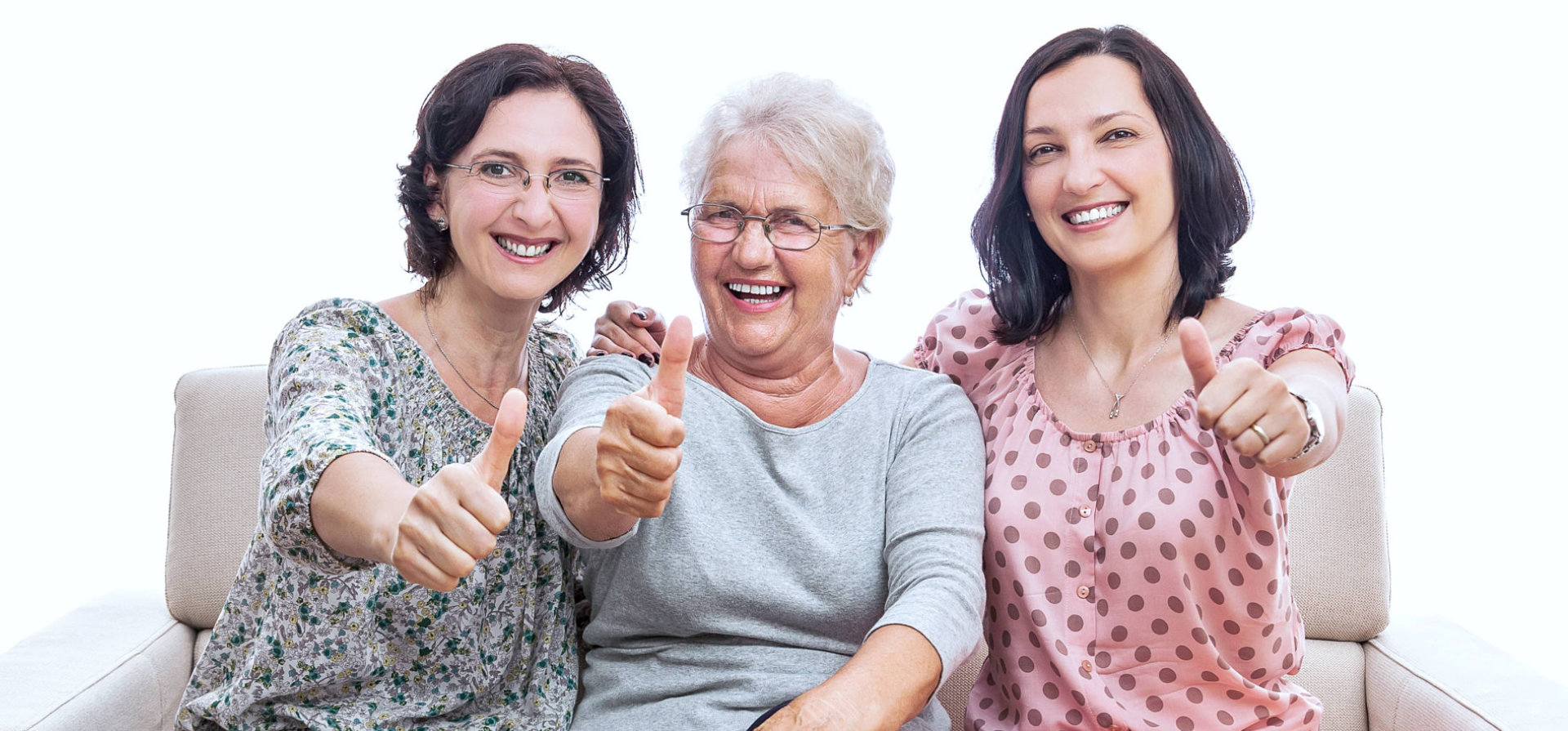 caregivers and an old patient smiling and giving an ok sign in front of camera
