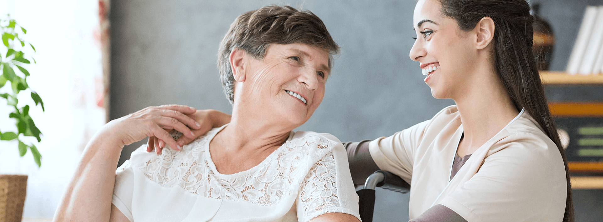 caregiver and her patient smiling at each other