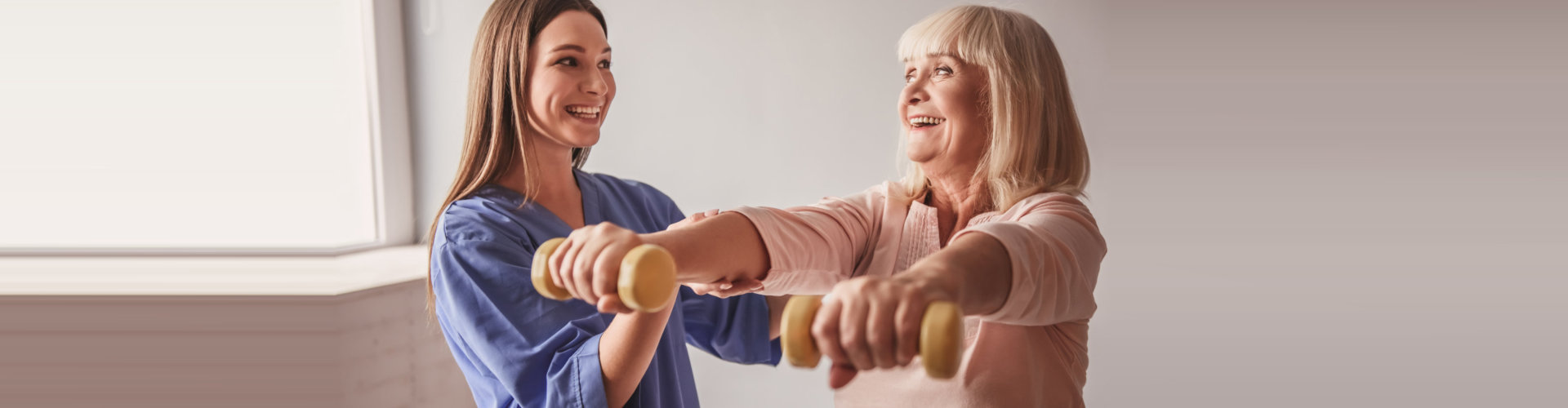 caregiver helping her patient work out