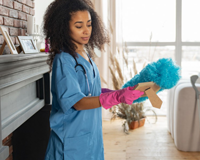 a caregiver cleaning the house