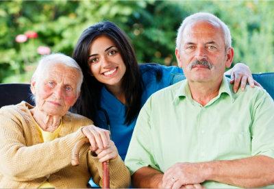 a caregiver with senior couple